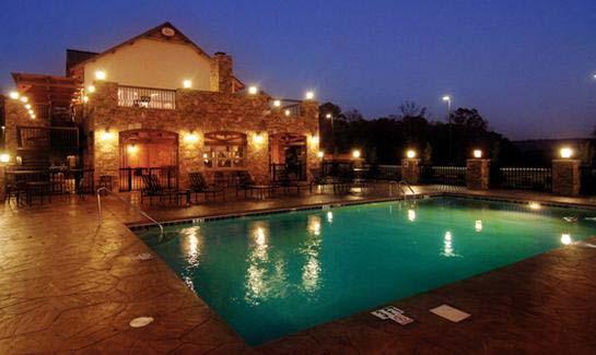 Grande Vista Bay Club House and Pool at night
