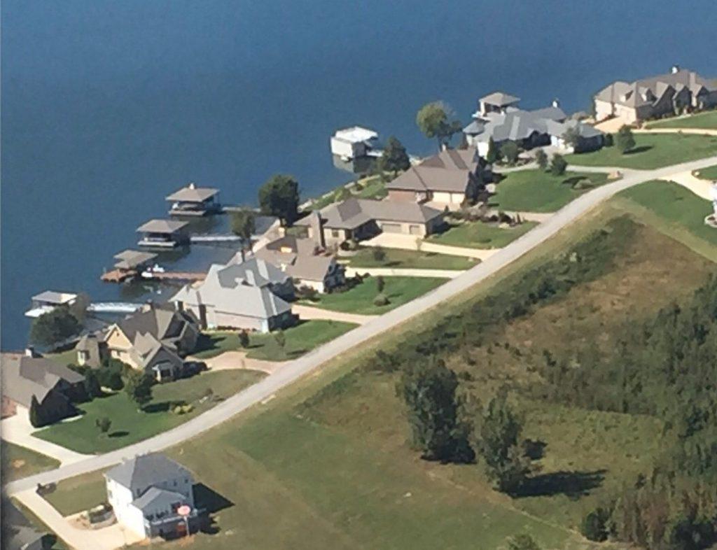 Aerial view of homes along lake at Grande Vista Bay