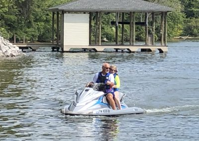 Couple on PWC in GVB cove.