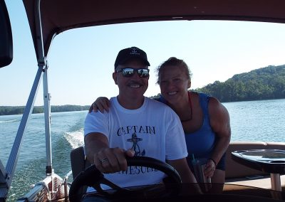 Smiling Captain and crew on Watts Bar Lake