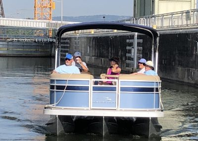 Locking through - group on pontoon