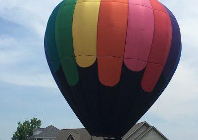 Hot air ballon lifting off from front yard at GVB