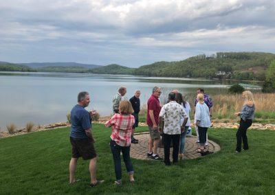 Group evening gathering at the lake