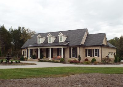 Traditional brick home at GVB, fountain in circular drive.
