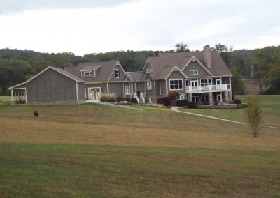 Long view to GVB home with gentle rolling land.