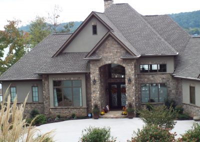 Close up front elevation of brick and stucco ranch home at GVB