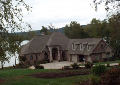 Copper roof dormer ranch lakefront home at GVB