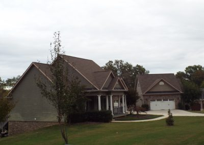 Home with white columns and separate garage in GVB