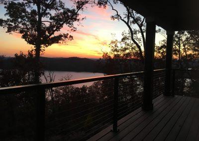 Orange sky at dusk from porch at Grande Vista Bay