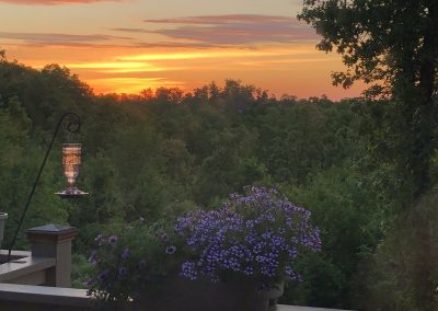 Sunset from a deck with hummingbird feeder
