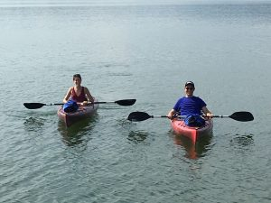 2 canoeists enjoy the lake at Grande Vista Bay
