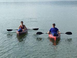 2 canoeists enjoy the lake at Grande Vista Bay